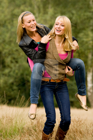 Bunnyhop in a park stock photo, Two sisters in a park having fun by Frenk and Danielle Kaufmann