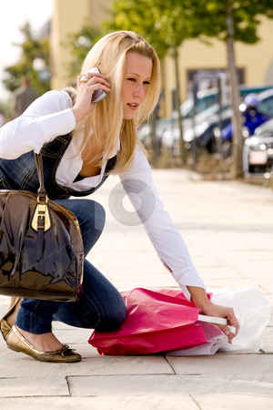 Ducking blond girl stock photo, Beauty young girl shopping in the sunny weather by Frenk and Danielle Kaufmann