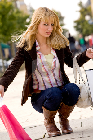Blond girl ducking stock photo, Beauty young girl shopping in the sunny weather by Frenk and Danielle Kaufmann