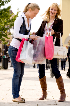 Happy with our bags stock photo, Two young girls shopping in the sunny weather by Frenk and Danielle Kaufmann