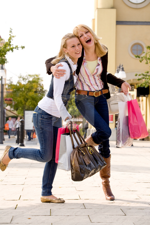 2 happy sisters stock photo, Two young girls shopping in the sunny weather by Frenk and Danielle Kaufmann