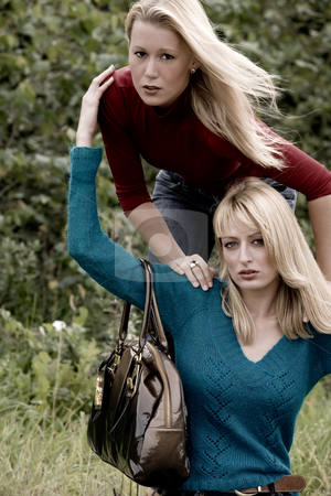 Happy fashion sisters stock photo, Two sisters in a park having fun by Frenk and Danielle Kaufmann