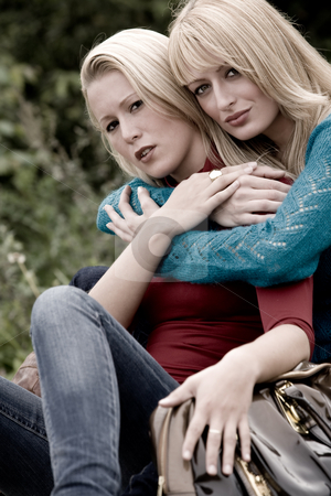 Hugging sisters stock photo, Two sisters in a park having fun by Frenk and Danielle Kaufmann