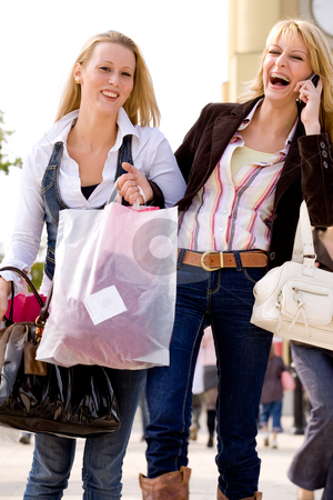 Calling somebody stock photo, Two young girls shopping in the sunny weather by Frenk and Danielle Kaufmann