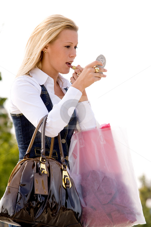 Do my make-up stock photo, Beauty young girl shopping in the sunny weather by Frenk and Danielle Kaufmann