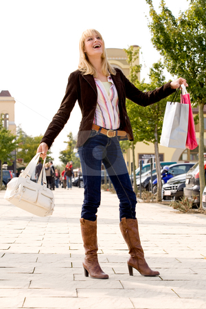 Happy blond girl stock photo, Beauty young girl shopping in the sunny weather by Frenk and Danielle Kaufmann