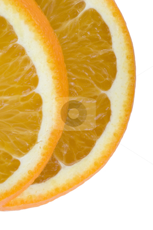 Orange slices stock photo, Two slices of orange on a white backdrop by Stephen Gibson