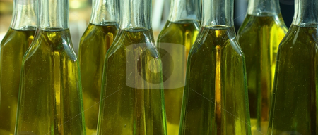 Olive oil in bottles stock photo, Home-made olive oil in bottles on a market by Natalia Macheda