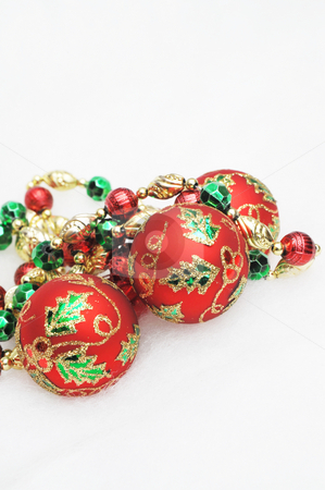 Decorative Christmas Ornaments stock photo, Red, green and gold Christmas decorations on a light background. by Lynn Bendickson