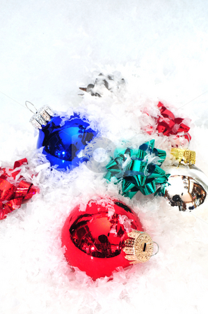 Christmas Ornaments And Bows stock photo, Christmas decorations and colorful bows in snow by Lynn Bendickson