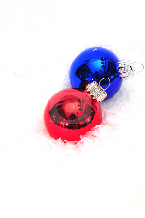 Red And Blue Christmas Tree Ornaments stock photo, Christmas tree decorations on a light background by Lynn Bendickson