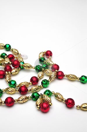 Christmas Bead Decoration stock photo, A strand of decorative beads for a christmas tree by Lynn Bendickson