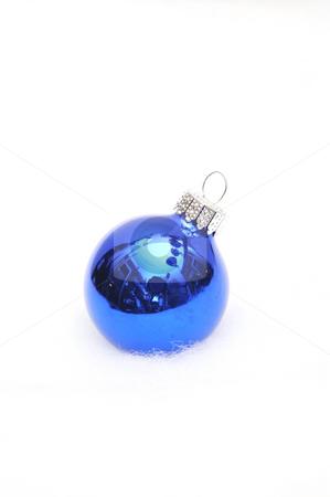 Blue Christmas Ornament stock photo, Singe blue ornament on a light fuzzy background by Lynn Bendickson