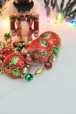 Christmas Decorations And Lights stock photo, Red, green and gold Christmas decorations with lights in the background. by Lynn Bendickson