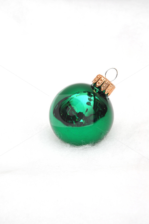 Green Christmas Ornament stock photo, Singe green ornament on a light fuzzy background by Lynn Bendickson