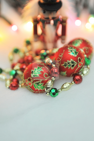 Christmas Lights And Decorations stock photo, Red, green and gold Christmas decorations with lights in the background - shallow DOF. by Lynn Bendickson
