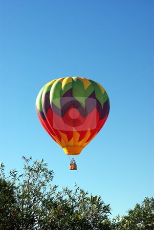 Hot Air Ballon And Clear Sky stock photo, A multi colored Hot Ait Ballon rises into a clear bright sky by Lynn Bendickson