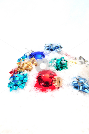 Bows And Christmas Decorations stock photo, Christmas decorations and colorful bows in snow by Lynn Bendickson