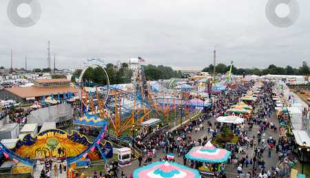 Carnival Midway stock photo, An aerial view of a carnival midway. by Robert Byron