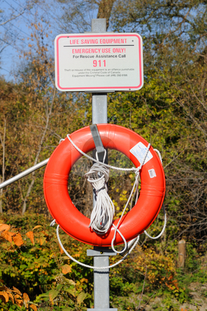Life saver stock photo, Life saving equipment in the woods by Will Burwell