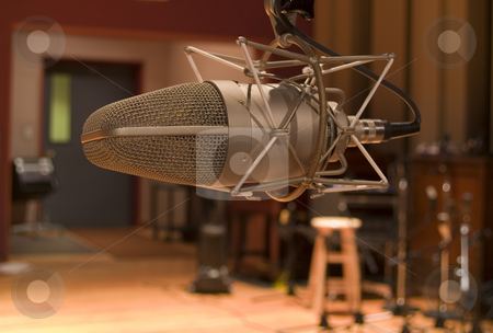 Studio Microphone stock photo, Expensive high end microphone in large recording studio. by John McLaird