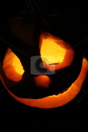 Halloween hikinx stock photo, A grinning jack-o-lantern by Jeffrey Newell