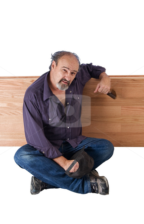 Alcohol provides relief for a Homeless man stock photo, Drunk man leans on a wooden devider by RCarner Photography