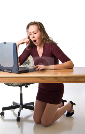 Awakes with a yawn stock photo, Young woman tired from computer work by RCarner Photography