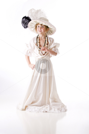 Little girl dressing-up stock photo, Playing by wearing grandmas hat and clothes by RCarner Photography