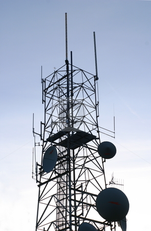 Communications Antenna stock photo, A radio and TV tower in silhouette at dusk. by Great Divide Photography