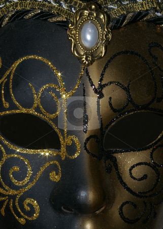 Black and gold mask stock photo, Venezian style black and gold mask. by Erik Lundberg