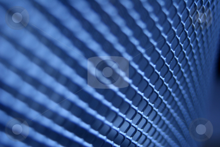 Blue Gridded Texture stock photo, A gridded texture toned blue with a limited depth of focus by Steve Smith