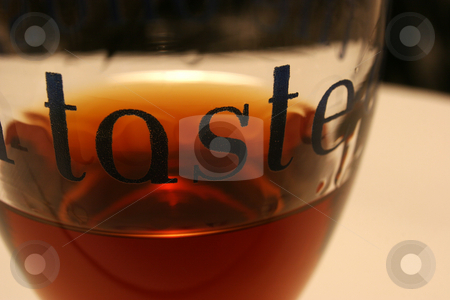 The Taste stock photo, A small glass of sherry with the word 'Taste' printed on the side by Steve Smith