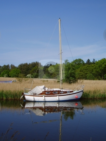Sailing Boat stock photo, Sailing boat moored on the Norfolk Broads, England by Waldy Wisniewski