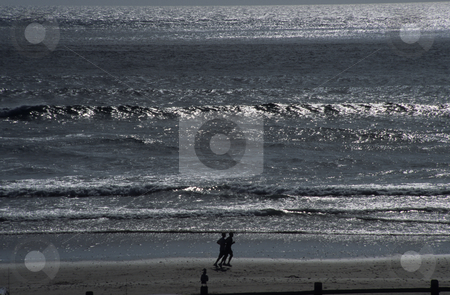 Joggers On The Beach stock photo, Joggers On The Beach Oceanside Oregon Coast by Mallorey Orcutt
