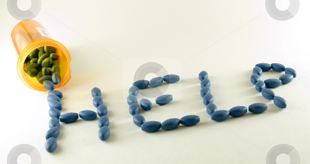 Pills Help stock photo, Big blue pills spell the word help. by John McLaird