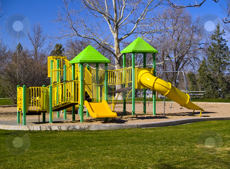 Playground at the Beginning of Spring stock photo, Playground in a park as spring returns. by John McLaird