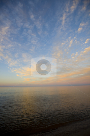 Clouds, Horizon, and Water stock photo, Clouds, horizon, an water during a sunset on the banks of Lake Superior. by John McLaird