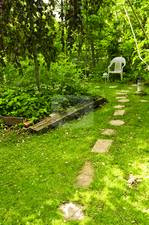 Green garden stock photo, Path of stepping stones leading to secluded corner in lush green garden by Elena Elisseeva