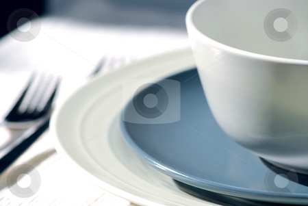 Place setting stock photo, Dinner place setting with plates and soup bowl by Elena Elisseeva