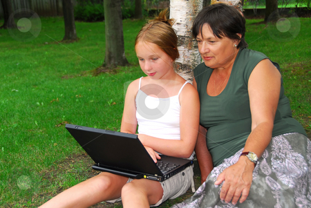 Family computer stock photo, Grandmother and granddaughter sitting outside with laptop computer by Elena Elisseeva