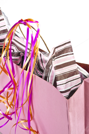 Pink shopping bag stock photo, Pink shopping bag with ribbons isolated on white background by Elena Elisseeva