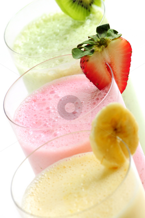 Fruit smoothies stock photo, Assorted fruit smoothies close up on white background by Elena Elisseeva