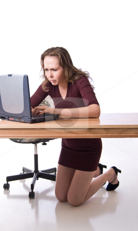 Determination to the extreme stock photo, Pretty young woman doing serious computing by RCarner Photography