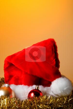 Santa Hat stock photo, A Santa Caus hat with Christmas ornaments and garland. by Robert Byron