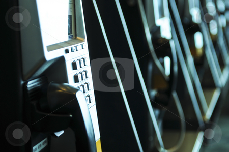 Row of pay phones stock photo, Row of pay phones in airport close up by Elena Elisseeva