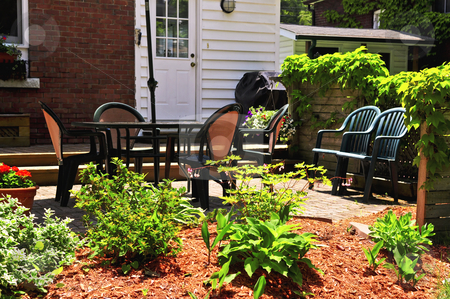 House patio stock photo, House patio with outdoor furniture and garden by Elena Elisseeva