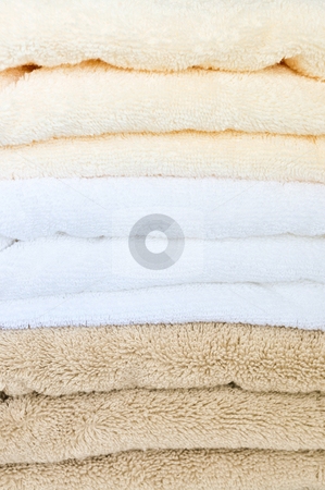 Stack of towels stock photo, Background of soft stacked towels close up by Elena Elisseeva