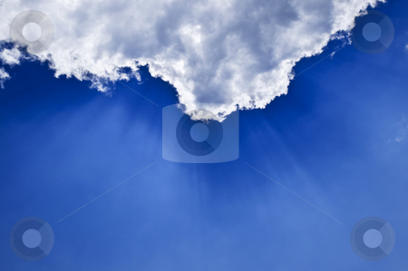 Blue sky with sunrays stock photo, Blue sky with sunrays shining from behind the clouds by Elena Elisseeva