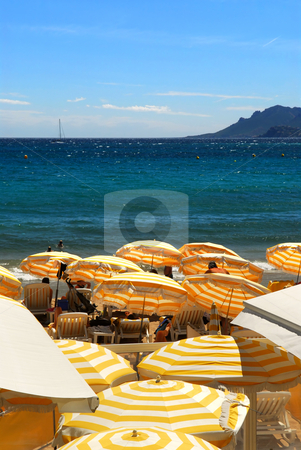 Beach in Cannes France stock photo, View on the beach from Croisette promenade in Cannes France by Elena Elisseeva